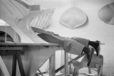 Eero Saarinen climbing inside model of TWA Flight Center