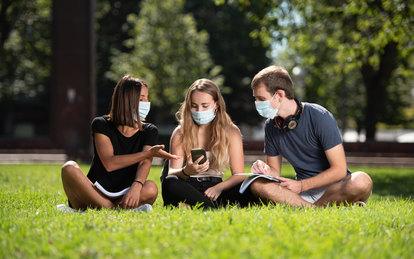 Students on Campus Lawn during COVID-19 Pandemic